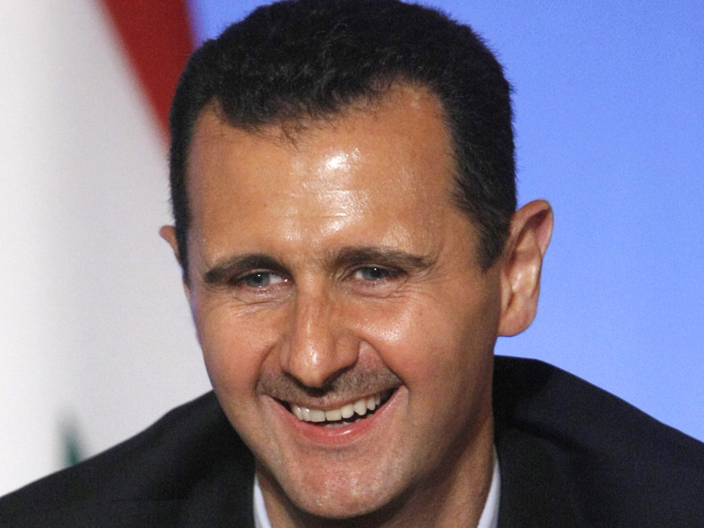 Syria's President Bashar al-Assad smiles during a news conference at the Elysee Palace in Paris, July 12, 2008.  REUTERS/Eric Gaillard