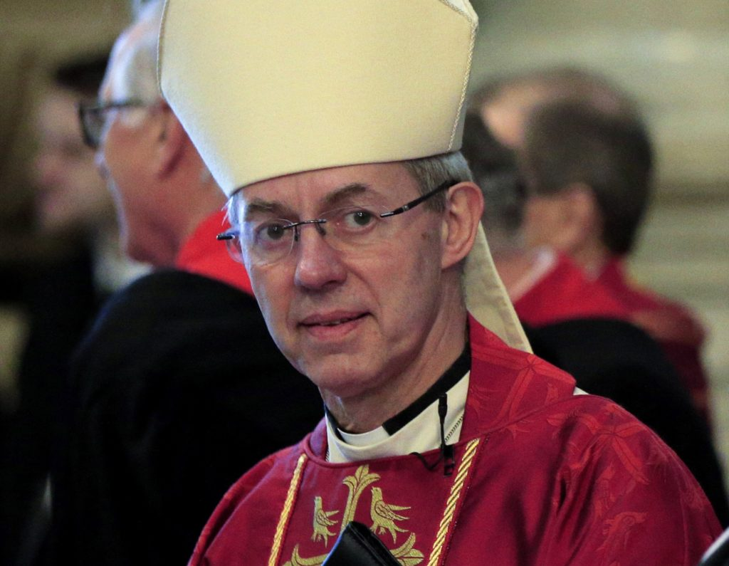 (FILES) This file photo taken on November 24, 2015 shows The Archbishop of Caterbury, Justin Welby, awaiting the arrival of Britain's Queen Elizabeth II ahead of a service at Westminster Abbey in central London. The Archbishop of Canterbury Justin Welby has confirmed that he is the illegitimate son of a one-time private secretary to Winston Churchill, after a newspaper reported the discovery late on April 8, 2016. / AFP PHOTO / POOL / JONATHAN BRADY